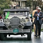 Jay Leno presenting award to 102year-old owner/driver